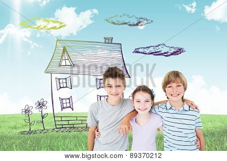 Happy brothers and sister standing arms around against blue sky over green field