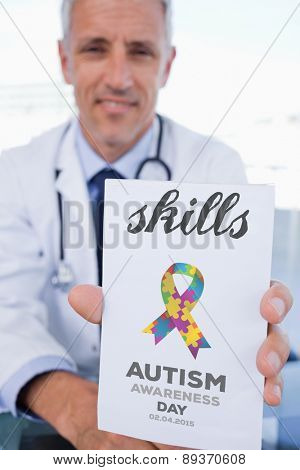 The word skills and portrait of a male doctor showing a blank prescription sheet against autism awareness day