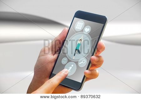 hand holding smartphone against futuristic bright grey background