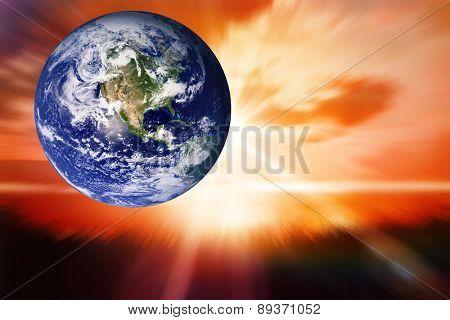 earth against sunrise over grass