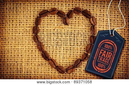 Fair Trade graphic against heart made out of coffee beans