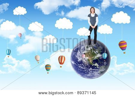 Happy woman smiling at camera against hot air balloons hanging from clouds