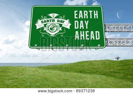 earth day ahead against green field under blue sky