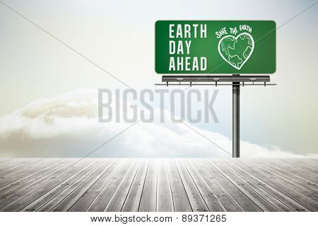 earth day ahead against wooden planks leading to bright sky