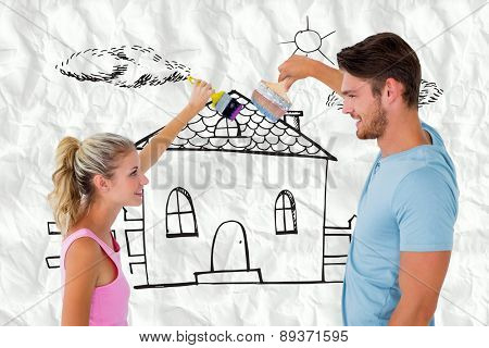 Young couple painting with brushes against crumpled white page