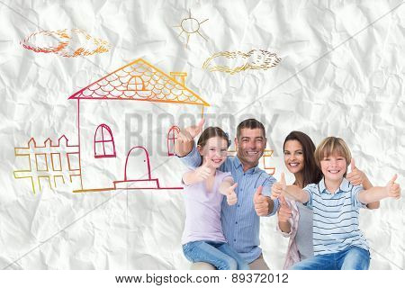 Happy family gesturing thumbs up against crumpled white page