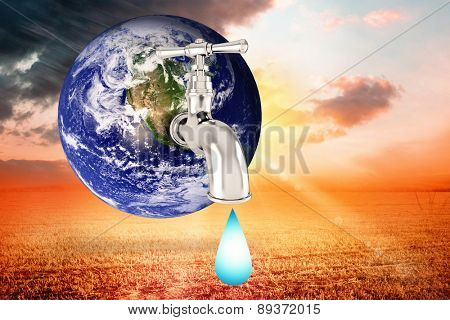 Earth with faucet against sunrise over field
