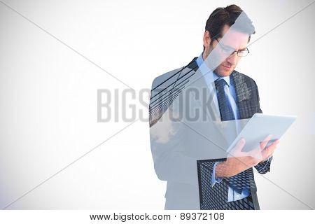 Businessman using a tablet computer against skyscraper