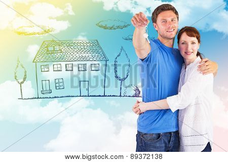 Couple holding keys to home against blue sky