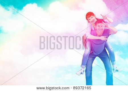 Man giving girl a piggy back against painted sky