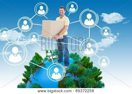 Man holding moving boxes against blue sky