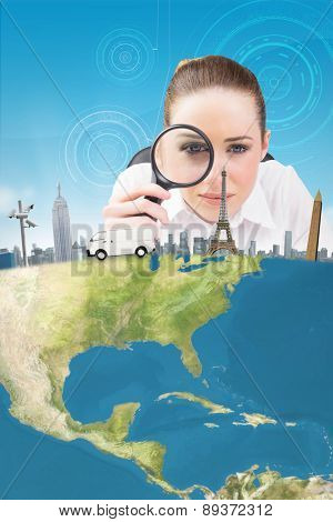 Thinking businesswoman with magnifying glass against futuristic technological background