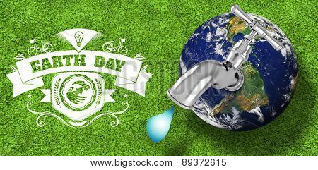 Earth with faucet against astro turf surface
