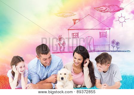 Family looking at puppy while lying against green grass under blue sky