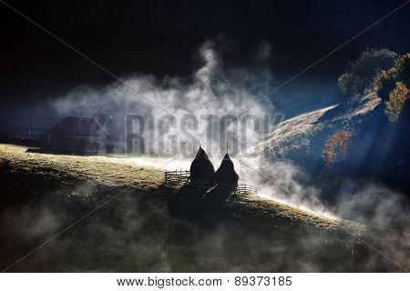 mountain landscape with autumn morning fog at sunrise