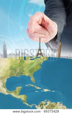Businessman pointing with his finger against futuristic technological background