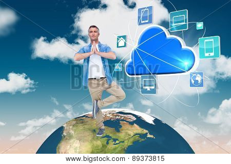 Man with grey hair in tree pose against blue sky