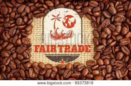 Fair Trade graphic against coffee beans with rectangular indent for copy space