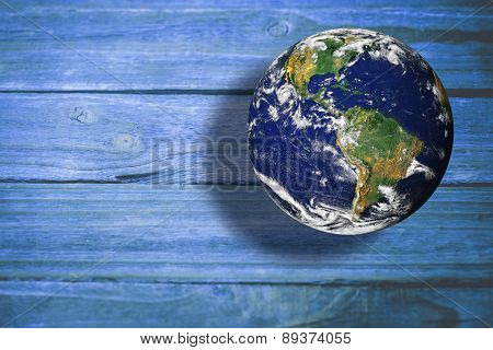 earth against wooden background