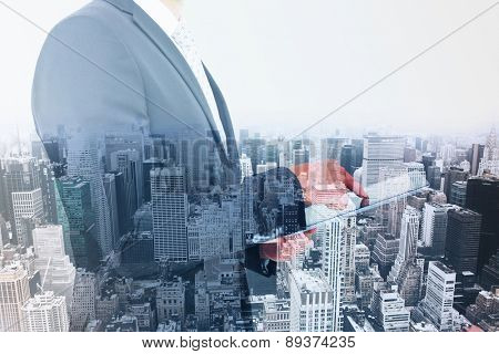 Businessman using his tablet pc against high angle view of city