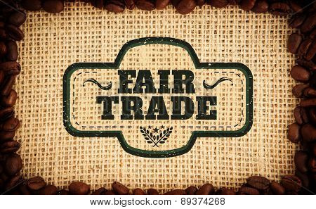 Fair Trade graphic against frame of coffee beans