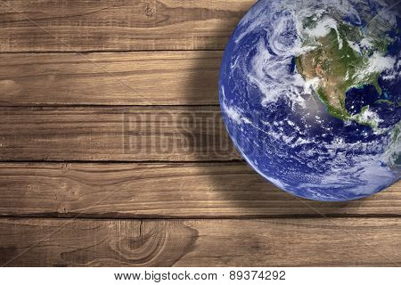 earth against overhead of wooden planks