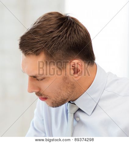 serious businessman in office working