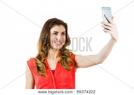 Pretty brunette taking a selfie on white background