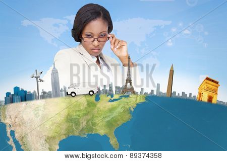 Thinking businesswoman against bright blue sky