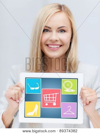 technology, people and shopping online concept - smiling woman showing tablet pc computer screen with fashion icons over gray background