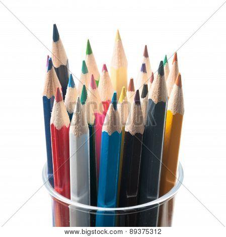 Multi colored pencils in glass jar