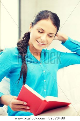 bright picture of happy and smiling woman with book..