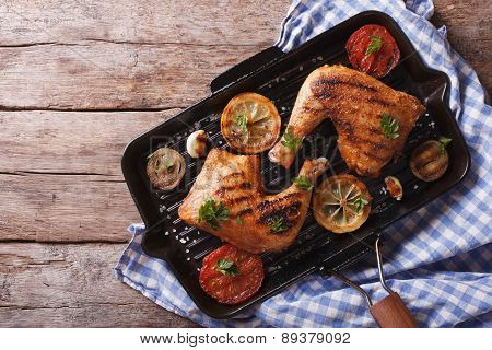 Chicken Leg And Vegetables On The Grill Pan. Horizontal Top View