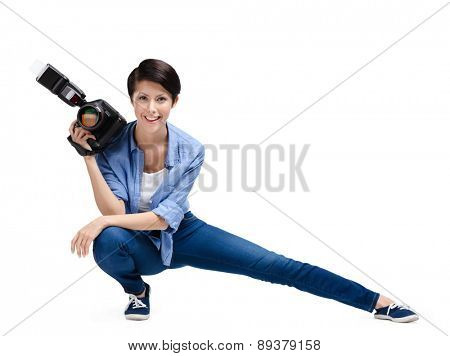 Woman-photographer takes photos, isolated on a white background