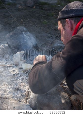 A Man Lighting A Fire.