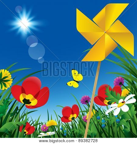 Meadow flowers and windmill propeller under the summer blue sky. Season natural background