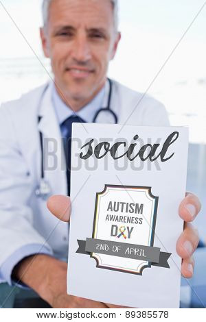 The word social and portrait of a male doctor showing a blank prescription sheet against autism awareness day