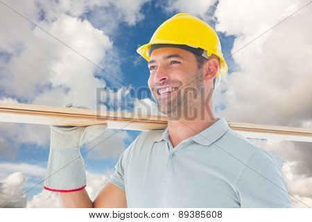 Carpenter against blue sky with white clouds
