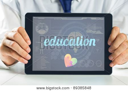 The word education and autism awareness heart against medical biology interface in blue
