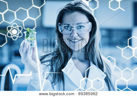 Science graphic against student standing at the laboratory smiling
