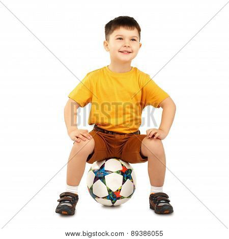 Cool Little Boy Sitting On A Soccer Ball