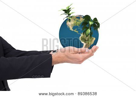 Businessman with arms out presenting something against little green seedling with leaves growing