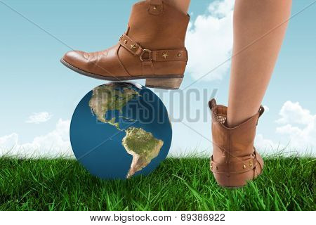 Cowboy boots dancing against blue sky