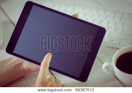Woman using her tablet pc in her office