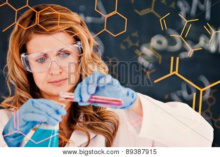 Science and medical graphic against young female scientist carrying out an experiment
