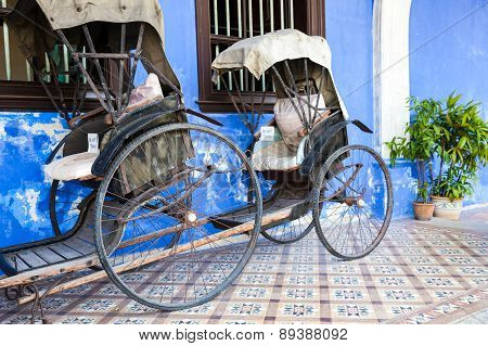 Old rickshaw tricycle near Fatt Tze Mansion or Blue Mansion, Penang