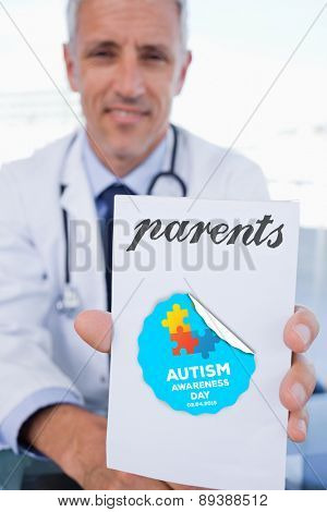 The word parents and portrait of a male doctor showing a blank prescription sheet against autism awareness day