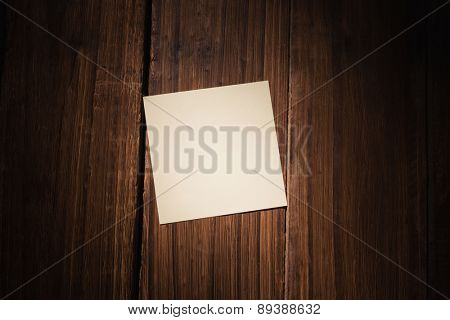 White post it on wooden background