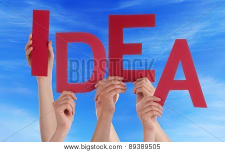 Many People Hands Holding Red Word Idea Blue Sky