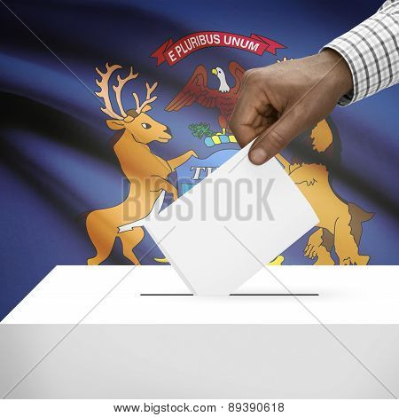 Voting Concept - Ballot Box With Us State Flag On Background - Michigan
